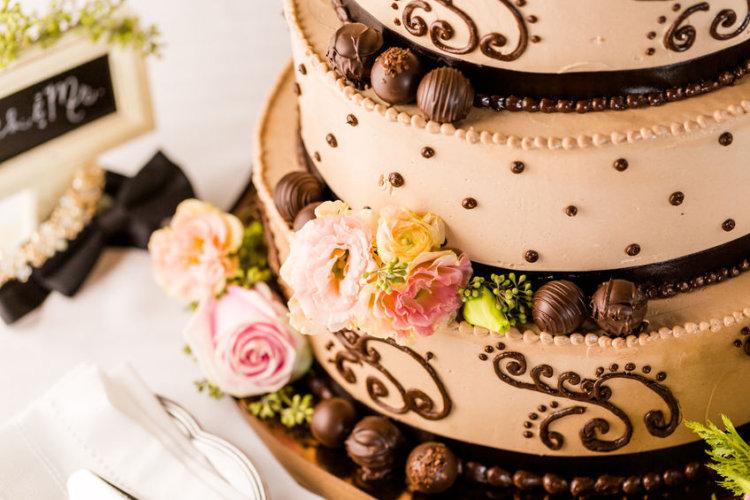 32870204 - gourmet tiered wedding cake at wedding reception.